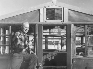 Heinie Snider building his greenhouse.