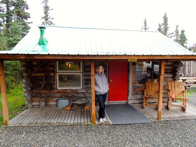 Abby standing by the cabin. Photo by Chuck Heath Jr.