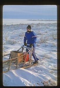 Meg riding sled runners.