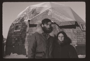 Alex and Meg standing in front of the new geodesic dome house they were building in Kotzebue in December 1975.