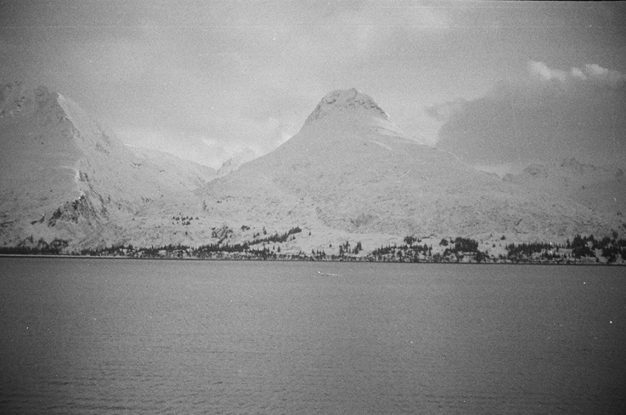 A black and white photograph from the 1940's looking across the bay from Valdez.  Photo courtesy of www.alaskapicker.com.