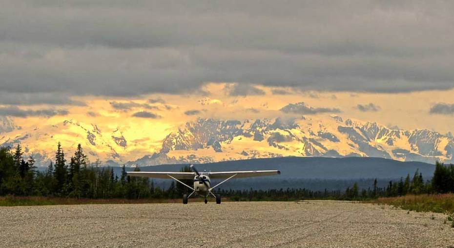 A plane lands on a gravel runway in Beluga, Alaska. The only way to access the river is by plane or boat. Credit: Paul Moinester