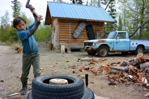 Nine-year-old Simm Scarola splits wood. Credit: Sam Weis