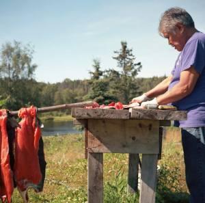 Al Goozmer processing salmon. Credit: Sara Quinn