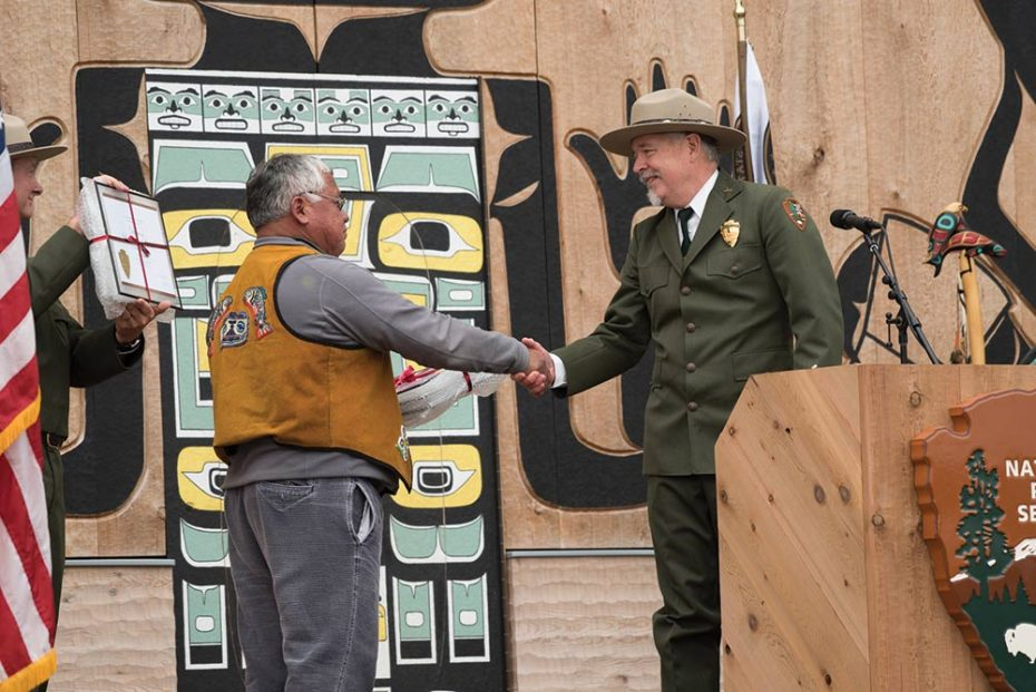 Hoonah Indian Association President Frank Wright shakes hand with National Park Service Superintendent Philip Hooge as they receive an award from the National Park Service recognizing the success of the collaboration.