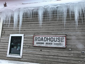The historical Talkeetna Roadhouse building in winter.