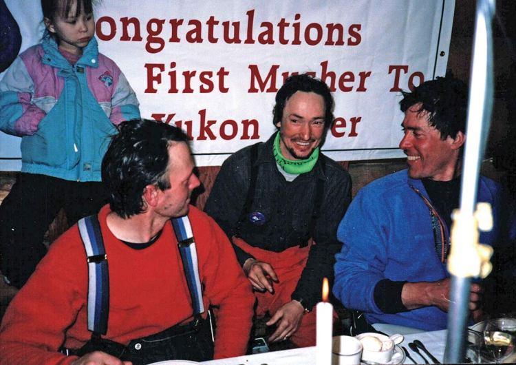 Denis between Iditarod mushers Joe Runyan and Doug Swingley.